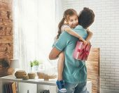 Happy loving family and Fathers Day. Father and his daughter. Cute child girl gives a gift to dad. poster