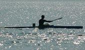 image of siluet  - siluete of man on racing kayak during competition - JPG