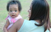 stock photo of mother daughter  - portrait of mother and child outdoors at a family gathering - JPG