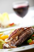 foto of chateaubriand  - bacon on a steak with vegetables and a glass of wine - JPG
