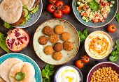 Table Served With Middle Eastern Traditional Dishes poster