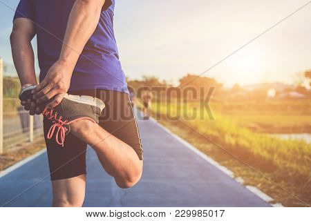 poster of Man Workout And Wellness Concept : Asian Runner Warm Up His Body Before Start Running On Road In The