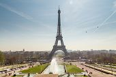 Eiffel Tower and fountain at Jardins du Trocadero at sunrise in Paris, France. Travel background poster