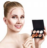 Young Woman With Contouring Make-up Holding Palette For Contouring Face. Isolated On White Backgroun poster
