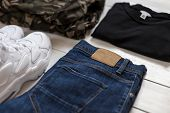 Mens Summer Collection Of Fashion Clothes On A White Wooden Background. Sneakers, T-shirt, Military poster