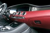 Modern Luxury Car Inside. Interior Of Prestige Modern Car. Comfortable Leather Seats. Red Perforated poster