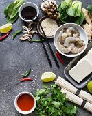 Various Asian Ingredients On A Dark Background. Asian Cooking Ingredients. Asian Food Concept. Open  poster