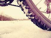 Close-up Of The Rear Wheel Of Mountain Bicycle In Snowy Meadow In The Countryside. Detail Of The Mou poster