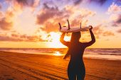 Surf Girl With Long Hair Go To Surfing. Woman With Surfboard On A Beach At Sunset. poster