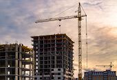 Building Crane And Building Under Construction. Construction Site. Construction Cranes And High Rise poster