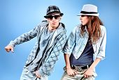 stock photo of rap-girl  - A couple of young man and woman dancing hip - JPG
