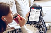 Woman Reading News On Tablet With Cup Of Coffee. Online Education Concept. E-learning poster