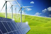 Renewable Or Green Energy Concept With Solar Panels And Wind Turbines On A Green Meadows poster