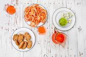 Prepared  Shrimps, Bread, Guacamole, Aperol Spritz And Blue Cheese Over White Wooden Background. Pic poster