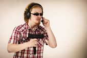 Nerd Geek Young Adult Man Playing On The Video Console Holding Gun Wearing Headphones With Microphon poster