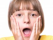 Emotional Portrait Of Excited Little Girl. Funny Cute Surprised Child 10 Year Old With Mouth Open In poster