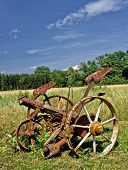 foto of horse plowing  - Traditional rusty horse powered grass mower on meadow in summer - JPG