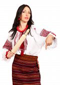 Angry Housewife With Rolling Pin. Woman Wears Ukrainian National Dress
