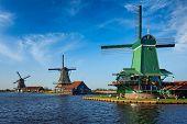 Netherlands rural lanscape Windmills at famous tourist site Zaanse Schans in Holland. Zaandam, Nethe poster