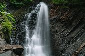 Beautiful Waterfall In Summer. A Fast Waterfall. View Of The Waterfall From Below poster
