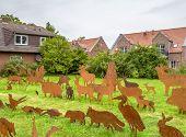Idyllic Scenery Including Some Rusty Metallic Animal Silhouettes In Greetsiel, A Idyllic Village Loc poster