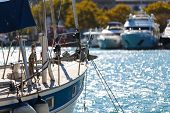 Board Sailing Yacht Parked In The Port On The Background Of Other Yachts, Depth Of Field Blur poster