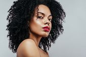 African American Fashion Model Portrait. Brunette Curly Haired Young Woman. Beauty Salon And Haircar poster