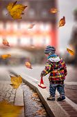Child Playing With Boat In Autumn. Child In Colored Jacket Playing On Street In Autumn. Children In  poster