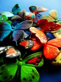pic of blue butterfly  - Toy butterflies on blue  background - JPG