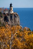 Autumn Fall Leaves With Split Rock Lighthouse In The Distance On Lake Superior Minnesota poster