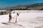 Couple In Pamukkale. Man And Woman Traveling. Couple In Love Walking. Travelling To Turkey. Honeymoo poster