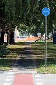 Round Blue And White Start Of Bicycle Track Lane Road Sign Next To Paved Bicycle Track Surrounded Wi poster