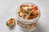 Dried Spices, Sun-dried Tomatoes, Dried Carrots, Basil And Herbes De Provence In A Glass Jar Copy Sp poster