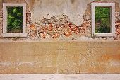 picture of former yugoslavia  - Abstract wall background damaged during war in former yugoslavia - JPG