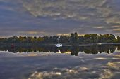 The Coast Of The River At Dawn - A Yacht Floats On The River. Morning On The River. Hdr Image poster