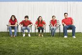 image of lawn chair  - Mixed Race family sitting in lawn chairs - JPG
