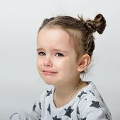 Crying little girl. Upset kid. Sad kid portrait. Cute little gilr crying and does not want to go in  poster
