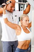 stock photo of personal trainer  - fitness woman and personal trainer in gym - JPG