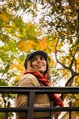 Portrait Of Beautiful Woman In Autumn. Beautiful Woman Portrait In Autumn. Woman With Autumn Leaves  poster