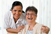 stock photo of elderly  - a nurse in aged care for the elderly in nursing homes - JPG