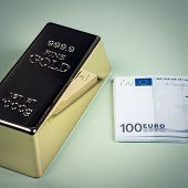 Euro Cash And Gold Bar On A Green Background. Banknotes. Money. Bill. Ingot. Bullion. poster