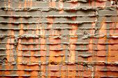 image of grout  - broken bricks in brickwall in wall construction with cement grout - JPG