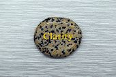Speckled Clarity Mood Stone On A Gray Background poster