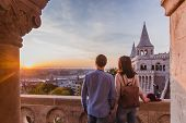 Young Couple Enjoy The View From The Point From Fisherman Bastion In Budapest During Sunrise. poster