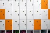 Luggage Storage For Things. Wooden Cells In White And Orange, With Metal Handles And Locks. Cells Nu poster