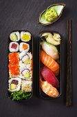 stock photo of masago  - bento box with sushi and rolls - JPG