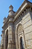 foto of cameos  - Vertical take of the Gateway of India with a cameo view of the Taj Hotel from an angled view of an archway - JPG