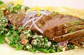 picture of tabouleh  - Sliced Middle Eastern lamb fillet with hommus and tabouleh - JPG