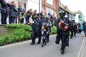 HASTINGS, ENGLAND - MAY 7: Musicians perform during a parade through the Old Town at the Jack In The