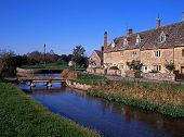 River in village, Lower Slaughter, Cotswolds, UK.